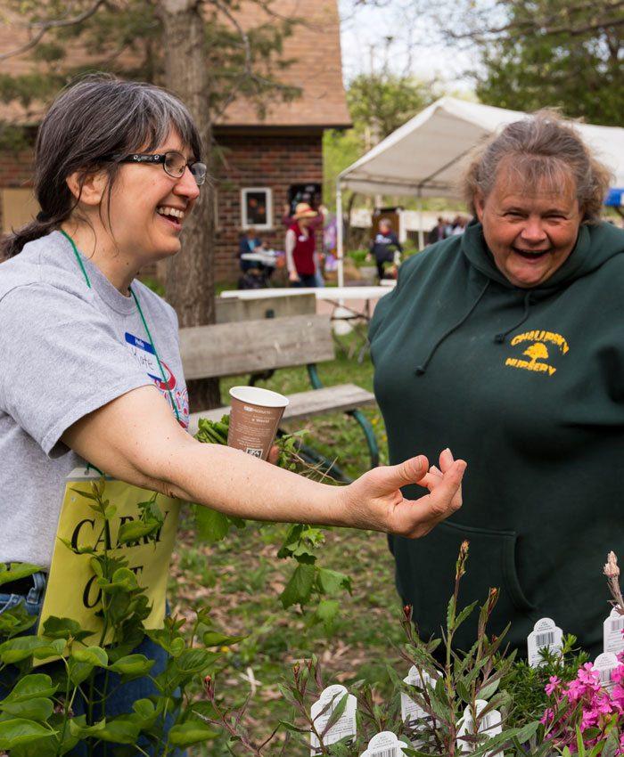 volunteer-looking-at-plants